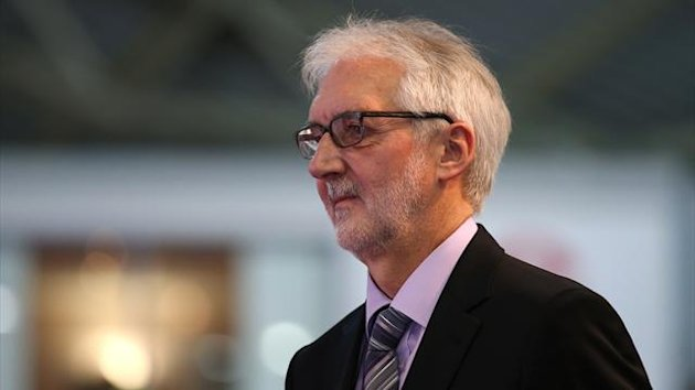 MANCHESTER, ENGLAND - NOVEMBER 03: President of the Union Cycliste Internationale, Brian Cookson OBE, looks on as he awaits a podium ceremony on day three of the UCI Track Cycling World Cup at Manchester Velodrome on November 3, 2013 in Manchester, Englan