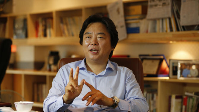 """In this July 18, 2012 photo, Shin Cheol-soo, chief executive of ENA Industry, speaks at his office in Gyeongsan, south of Seoul, South Korea. Shin no longer sees his future in the United States. The South Korean auto parts supplier uprooted his family from Detroit this year and moved home to focus on selling to the new economic superpower: China. """"The United States is a tiger with no power,"""" Shin said in his office, where three walls are lined with books, many about China. """"Nobody can deny that China is the one now rising."""" (AP Photo/Lee Jin-man)"""