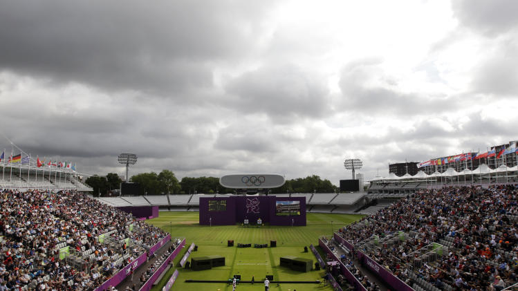 Lord's Cricket Ground hosts a match between Japan's Takahuru Furukawa, center left, and Norway's Baard Nesteng, center right, during the men's individual archery competition at the 2012 Summer Olympics, Friday, Aug. 3, 2012, in London. (AP Photo/Marcio Jose Sanchez)