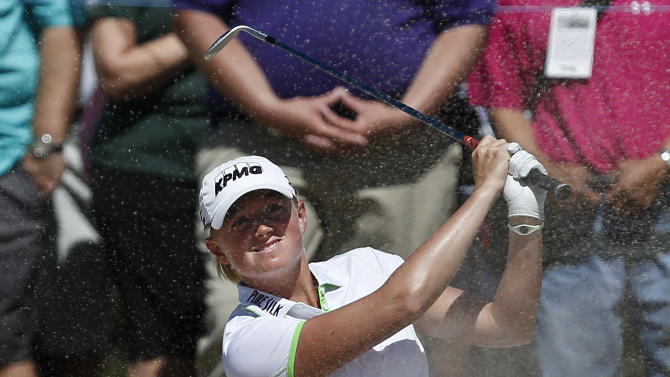 Stacy Lewis hits out of a bunker at the fifth hole during the final round of the LPGA Founders Cup golf tournament on Sunday, March 17, 2013, in Phoenix. (AP Photo/Ross D. Franklin)