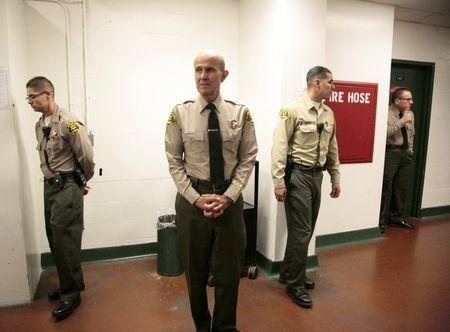 File photo of Los Angeles County Sheriff Baca waiting to visiting inmates in the Men's Central Jail following a news conference to address the Citizens' Commission on Jail Violence report on his department's management of the jail system in Los Angeles