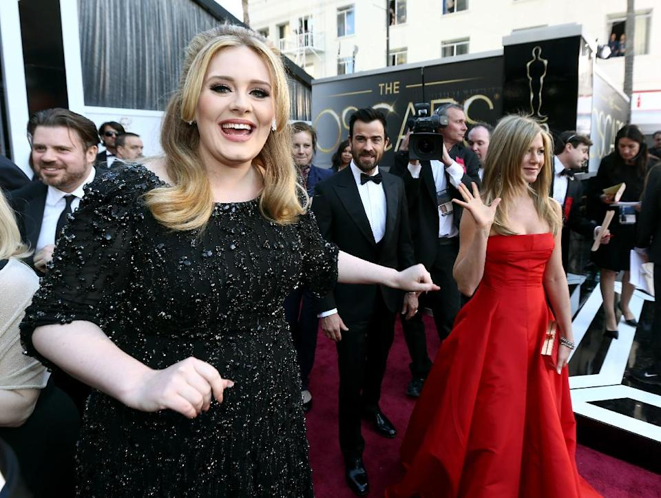 Adele, Justin Theroux and Jennifer Aniston, from left to right, arrive at the Oscars at the Dolby Theatre on Sunday Feb. 24, 2013, in Los Angeles. (Photo by Matt Sayles/Invision/AP)