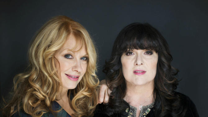"FILE - This Oct. 1, 2012 file photo shows sisters Ann, left, and Nancy Wilson from Heart in New York. The eclectic group of rockers Rush and Heart, rappers Public Enemy, songwriter Randy Newman, ""Queen of Disco"" Donna Summer and bluesman Albert King will be inducted into the Rock and Roll Hall of Fame next April in Los Angeles. The inductees were announced Tuesday by 2012 inductee Flea of The Red Hot Chili Peppers at a news conference in Los Angeles. (Photo by Victoria Will/Invision/AP Images)"