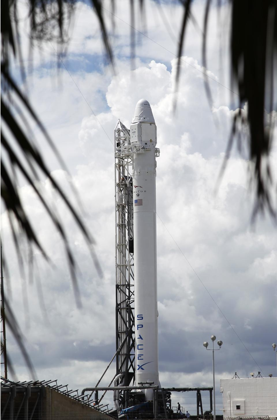 The Falcon 9 SpaceX rocket stands on space launch complex 40 ready for launch at the Cape Canaveral Air Force Station in Cape Canaveral, Fla. on Sunday, Oct. 7, 2012. Launch is scheduled for 8:35 PM Sunday on a supply mission to the International Space Station. (AP Photo/Terry Renna)