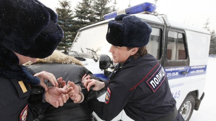 Special task force police officer Irina Samit demonstrates how to detain a suspect as she conducts a training session with her colleague in the suburbs of Russia's Siberian city of Krasnoyarsk