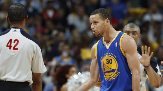 Golden State Warriors guard Stephen Curry (30) argues with referee Eric Lewis (42) after he was called for a foul in the fourth quarter of Game 5 of their first-round NBA basketball playoff series against the Denver Nuggets, Tuesday, April 30, 2013, in Denver. The Nuggets won 107-100. (AP Photo/David Zalubowski)