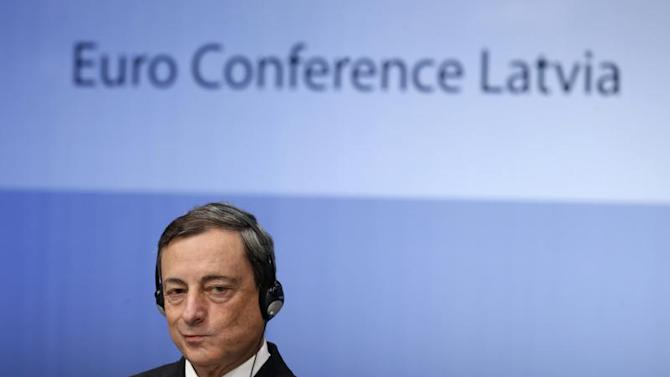 European Central Bank President Draghi listens during the Euro Conference Latvia 2013 in Riga