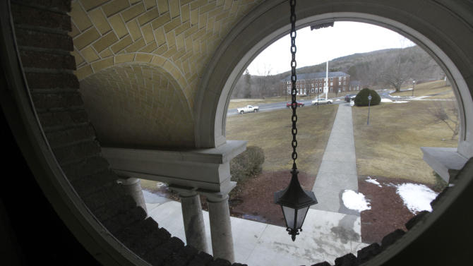 A view through a window at Kenarden Hall looks out onto an historic 217-acre campus in Northfield, Mass. in this photo taken Thursday, March 8, 2012. The campus, along with its 43 buildings, is being offered for free to an orthodox Christian group who can come up a solid plan to use it. (AP Photo/Elise Amendola)