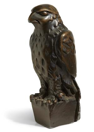 "In this undated photo provided by Bonham's Auction House, the ""Maltese Falcon"" is shown. The 45-pound, 12-inch-tall, black figurine cast in lead that was specifically made for John Huston's screen version of the film bears its name, will be offered at auction by Bonham's auction house in New York on Monday, Nov. 25, 2103. The famous prop is being offered in a sale of other classic movie memorabilia. (AP Photo/Bonham's Auction House)"