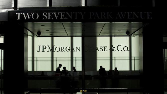 People walk inside JP Morgan headquarters in New York
