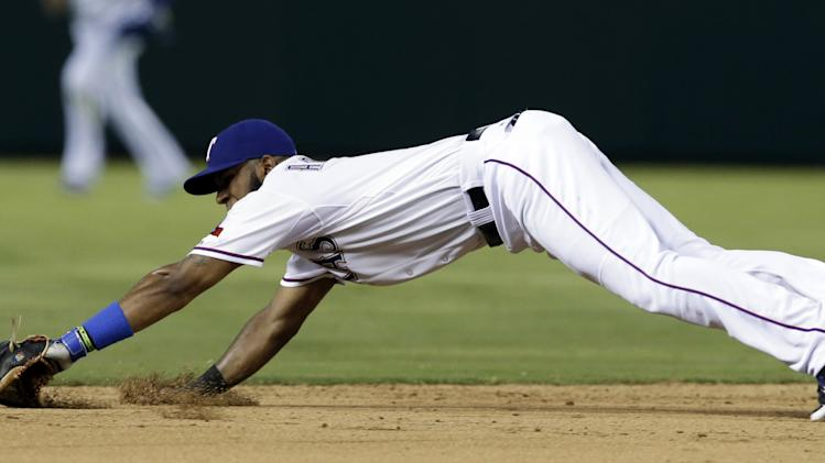 Texas Rangers shortstop Elvis Andrus is unable to reach a run-scoring single by Oakland Athletics' Yoenis Cespedes in the sixth inning of a baseball game, Friday, July 25, 2014, in Arlington, Texas. Eric Sogard scored on the hit. (AP Photo)