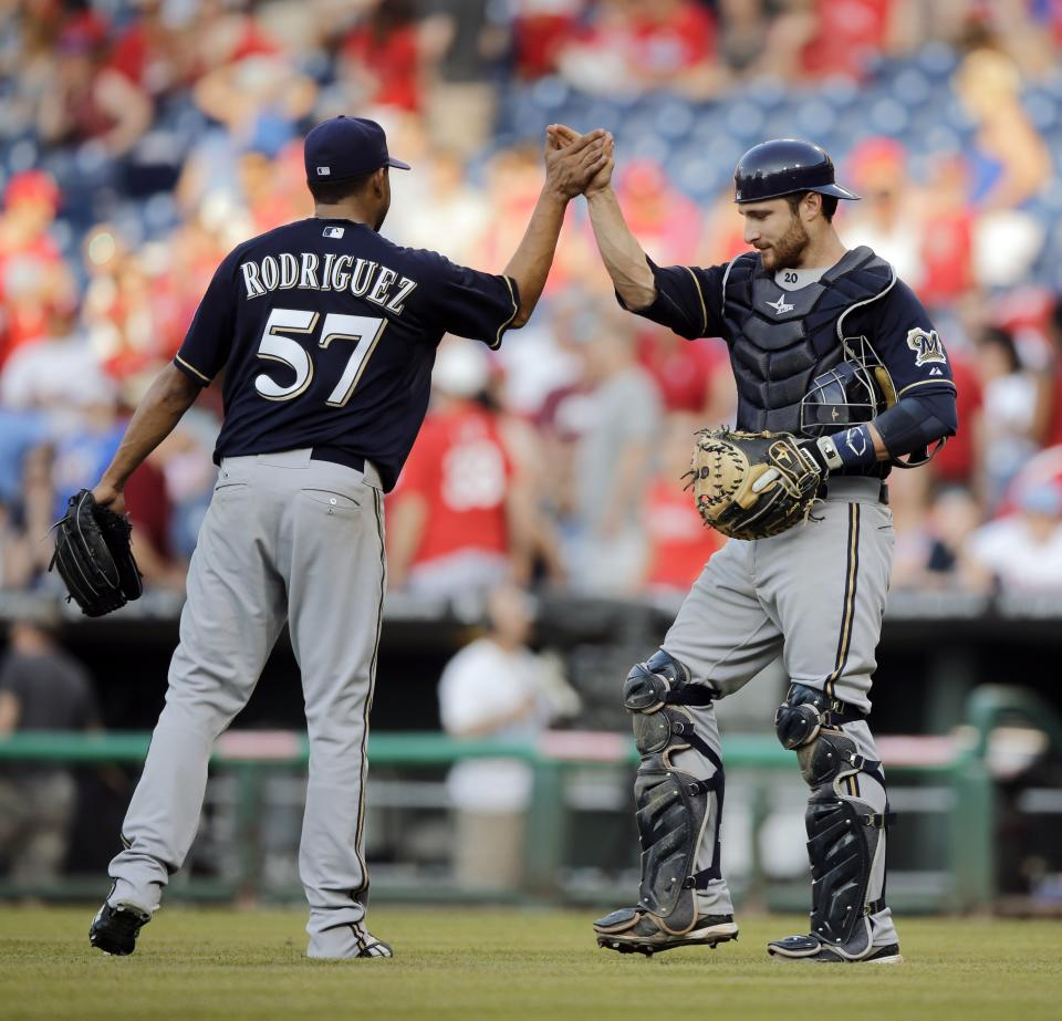 Milwaukee Brewers relief pitcher Francisco Rodriguez, left, and catcher Jonathan Lucroy celebrate after a baseball game against the Philadelphia Phillies, Saturday, June 1, 2013, in Philadelphia. The Brewers won 4-3.  (AP Photo/Matt Slocum)