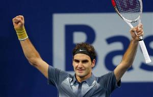 Switzerland's Roger Federer reacts after winning his semi-final match against Vasek Pospisil of Canada at the Swiss Indoors ATP tennis tournament in Basel