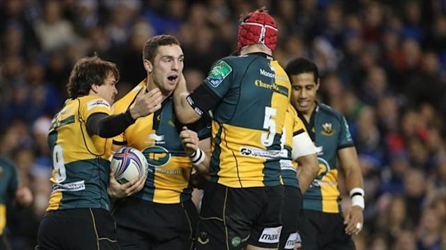 Northampton Saints George North (centre) celebrates scoring a try