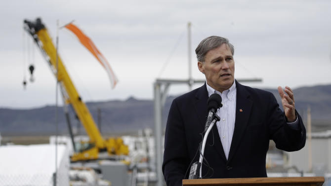 Washington Gov. Jay Inslee talks to reporters, Wednesday, March 6, 2013, as he tours the Hanford Nuclear Reservation near Richland, Wash. Inslee was at Hanford to meet with Dept. of Energy officials in order to learn more about tanks on the site that are leaking radioactive waste. (AP Photo/Ted S. Warren)