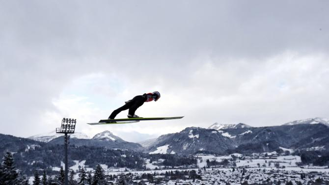 Freund from Germany soars through the air during the trial round for the first jumping of the 63rd four-hills ski jumping tournament in Oberstdorf
