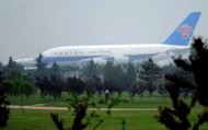 A China Southern Airlines plane wait for take-off at the Beijing Capital International airport. Shares in China Southern Airlines fell more than 5% on Tuesday after the company posted a slump in first-half net profit of 85% from a year earlier