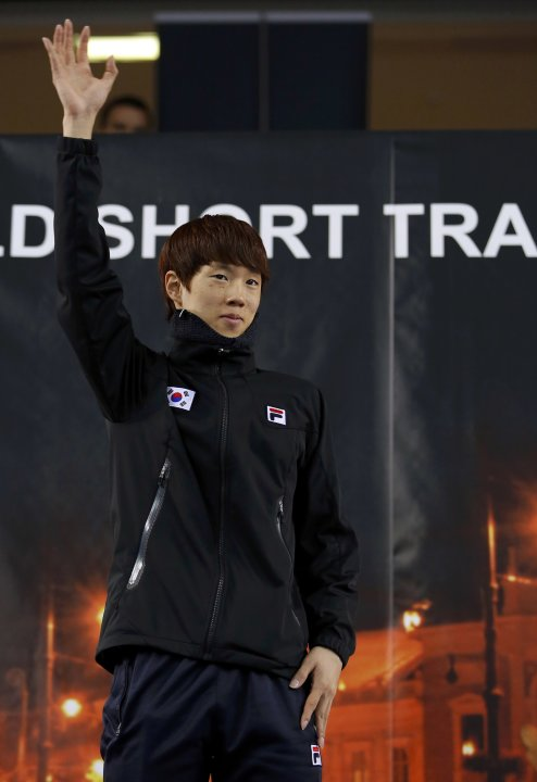 Winner Sin of South Korea celebrates on the podium after the men's 1500m finals at the ISU World Short Track Speed Skating Championships in Debrecen