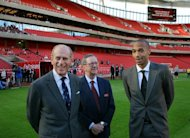 Britain&#39;s Prince Philip (L) is introduced to the Arsenal squad by Thierry Henry (R) and Chairman Peter Hill-Wood (C) as he officially opens the Emirates Stadium in London in 2006. Hill-Wood has admitted the club &quot;can&#39;t compete&quot; in the transfer market with rival Premier League teams