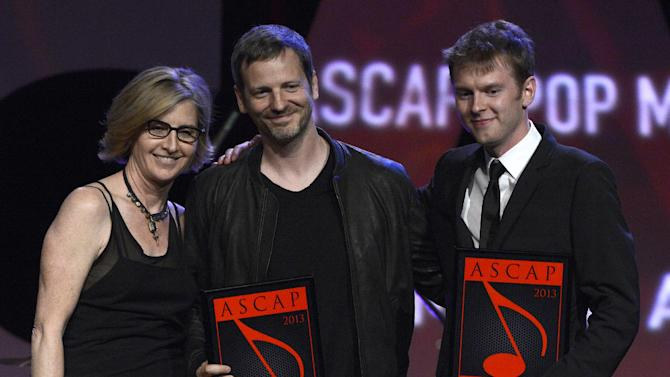 """ASCAP Vice President, Membership - Pop/Rock Sue Drew, Dr Luke and Cirkut who won the ASCAP Pop song award for """"Good Feeling"""" are seen onstage at the 30th Annual ASCAP Pop Music Awards, on Wednesday, April 16, 2013, at Loews Hollywood Hotel in Hollywood, California. (Photo by Phil McCarten/Invision for ASCAP/AP Images)"""