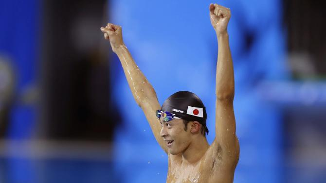 Japan's Irie reacts after winning in the men's 100m backstroke final swimming competition during the 17th Asian Games in Incheon