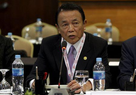 Japan's Finance Minister Taro Aso attends a meeting during the 2015 IMF/World Bank Annual Meetings in Lima