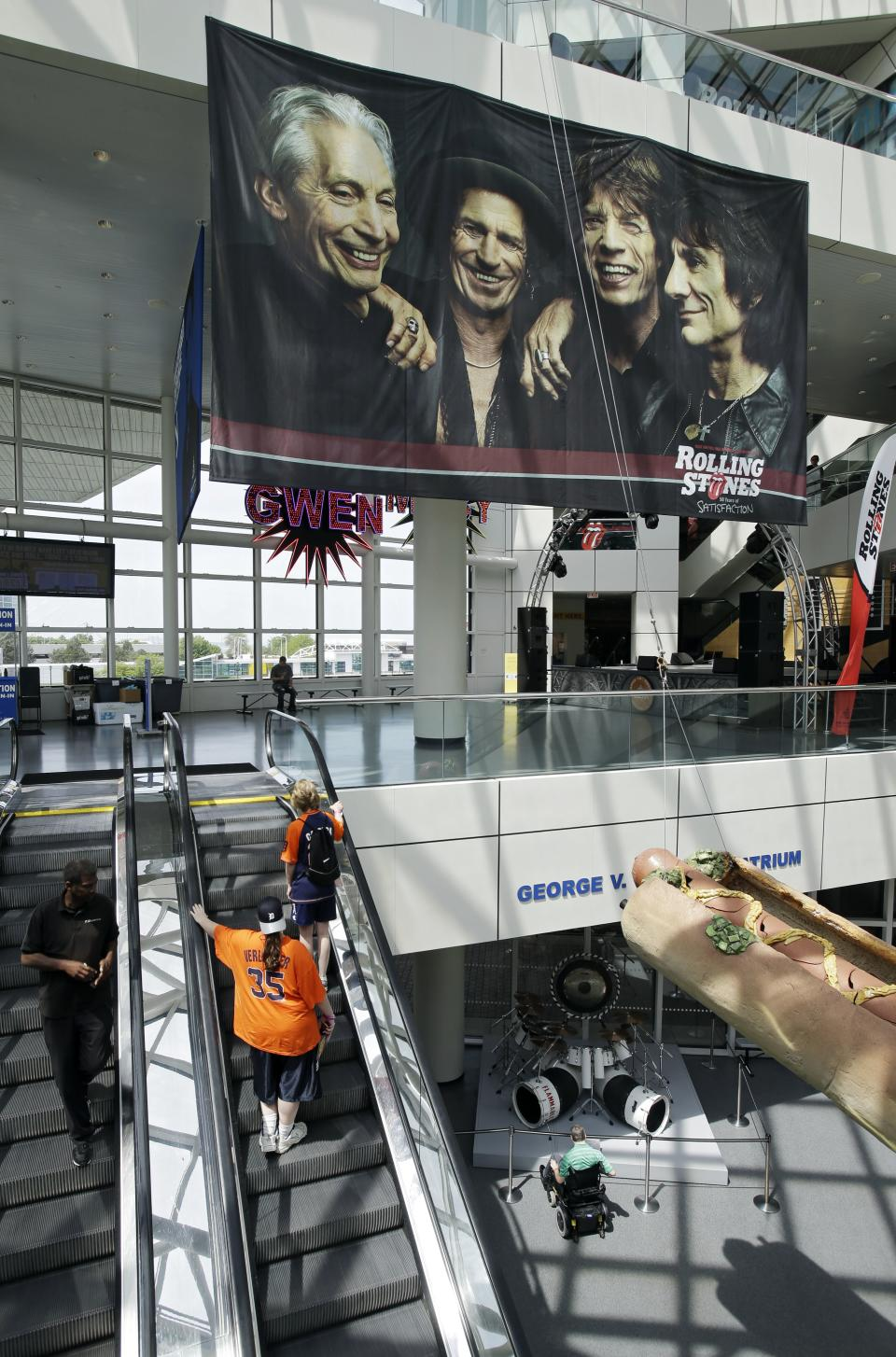 "In this May 21, 2013 photo, a large banner for a new exhibit, ""Rolling Stones 50 Years of Satisfaction"", greets visitors in the main atrium at the Rock and Roll Hall of Fame in Cleveland.  The exhibit opens on Friday. (AP Photo/Mark Duncan)"