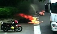 Motorcyclist Set Ablaze In China Lorry Crash