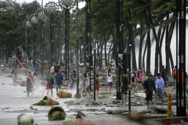Debris litter the scenic Roxas boulevard near a seawall in Manila after Typhoon Nesat battered the capital and other parts of northeastern Philippines Tuesday Sept. 27, 2011. Manila residents waded th
