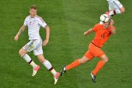 Danish forward Nicklas Bendtner (L) fights for the ball with Dutch defender Ron Vlaar during the Euro 2012 football match in Kharkiv. Denmark won 1-0