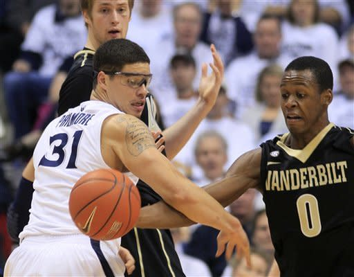Fuller leads Vanderbilt over Xavier 66-64 in OT