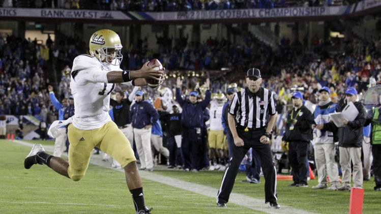 UCLA quarterback Brett Hundley runs into the end zone on a 5-yard touchdown run against Stanford during the first half of the Pac-12 championship NCAA college football game in Stanford, Calif., Friday, Nov. 30, 2012. (AP Photo/Tony Avelar)