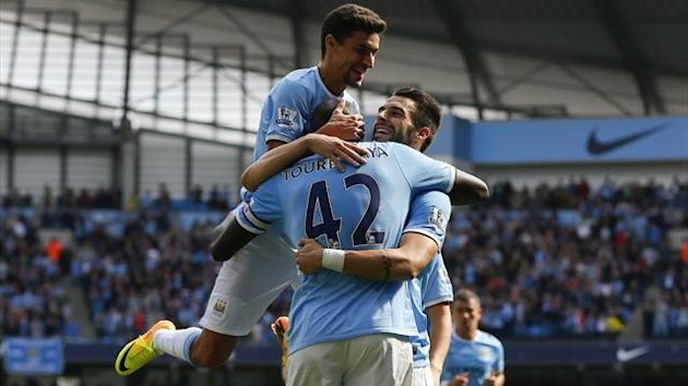 Jesus Navas, Yaya Toure and Alvaro Negredo celebrate (Reuters)