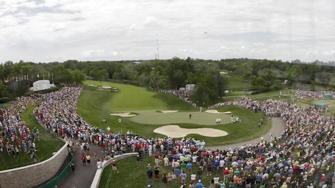A view from the newly built clock tower shows Tiger Woods putting on the 18th hole during the final round of the Memorial golf tournament Sunday, June 2, 2013, in Dublin, Ohio. (AP Photo/Jay LaPrete)