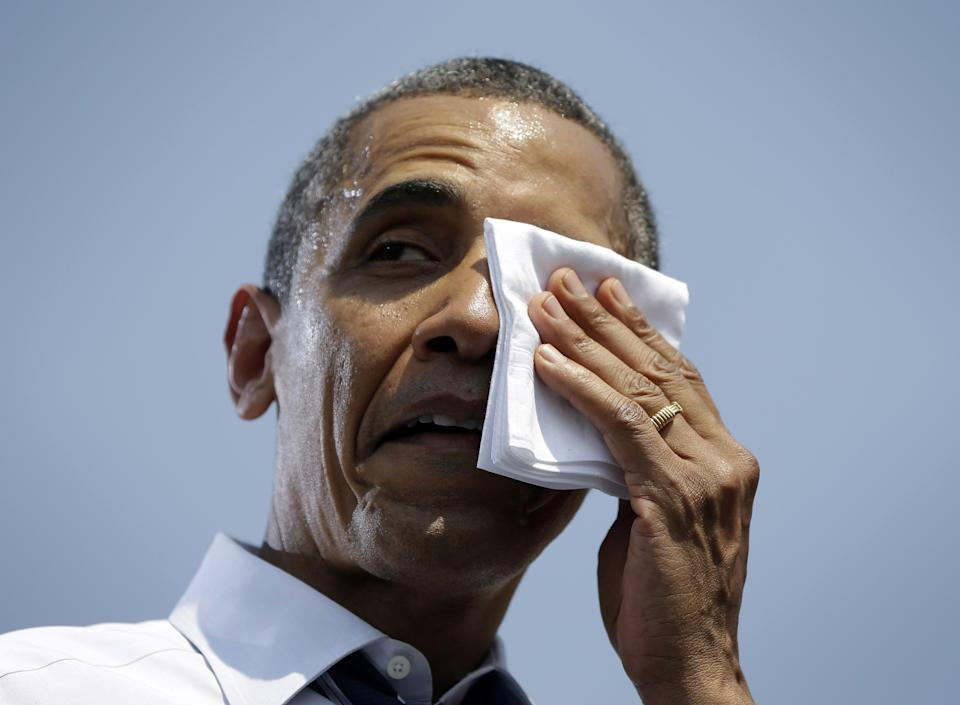President Barack Obama wipes his face at a campaign event at Iowa State University, Tuesday, Aug. 28, 2012, in Ames, Iowa. (AP Photo/Pablo Martinez Monsivais)