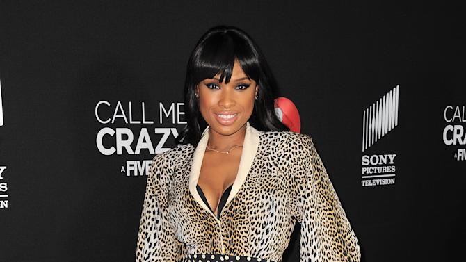 """FILE - In this April 16, 2013 file photo, Jennifer Hudson arrives at the world premiere of """"Call Me Crazy: A Five Film"""" at the Pacific Design Center, in Los Angeles. Hudson and Christina Aguilera are among the artists set to pay tribute to this year's eclectic group of Rock and Roll Hall of Fame inductees. Aguilera and Hudson are scheduled to perform in honor of late disco queen Donna Summer at the 28th annual induction ceremony on Thursday, April 18, 2013, at the Nokia Theatre in Los Angeles.  (Photo by Jordan Strauss/Invision/AP, File)"""