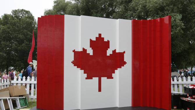 The completed Canadian flag made out of lego bricks is pictured at the Canada Day LEGO Flag Build, on Monday July 1, 2013 at Parc Jacques-Cartier Park in Gatineau, Quebec. For Canada Day, children could help build a Canadian flag made out of 128,000 LEGO bricks. (Francis Vachon / AP Images for LEGO Systems, Inc.)
