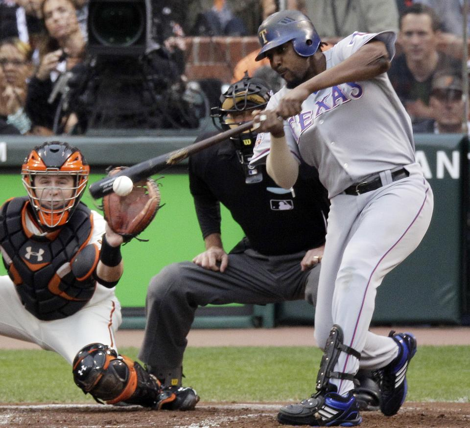 Texas Rangers' Vladimir Guerrero hits a run-scoring single off San Francisco Giants' Tim Lincecum during the first inning of Game 1 of baseball's World Series Wednesday, Oct. 27, 2010, in San Francisco. (AP Photo/Eric Gay)