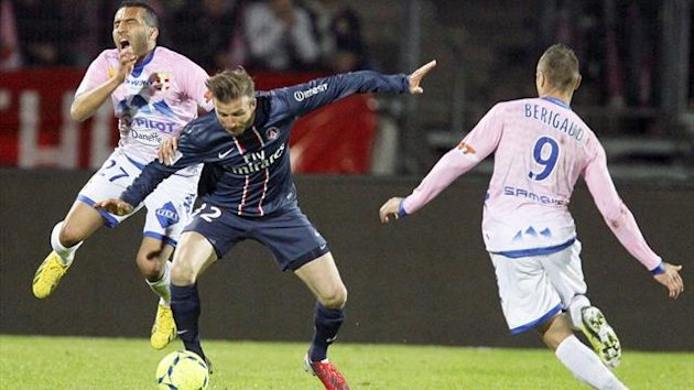 2013David Beckham (C) of Paris St-Germain challenges Youssef Adnane (L) of Evian Thonon Gaillard to receive a red card during their French Ligue 1 soccer match in Annecy April 28, 2013