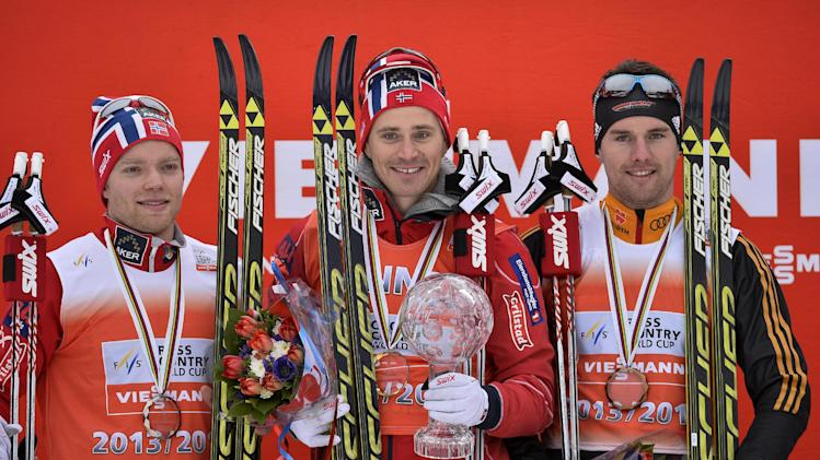 Norway's Ola Vigen Hattestad, centre, holds the winner's trophy for the men's FIS sprint World Cup cross country ski in Falun, Sweden, Friday March 14, 2014. Second placed Eirik Brandsdall, Norway, left, and third placed Josef Wenzl, Germany, at right. (AP photo / Anders Wiklund) SWEDEN OUT