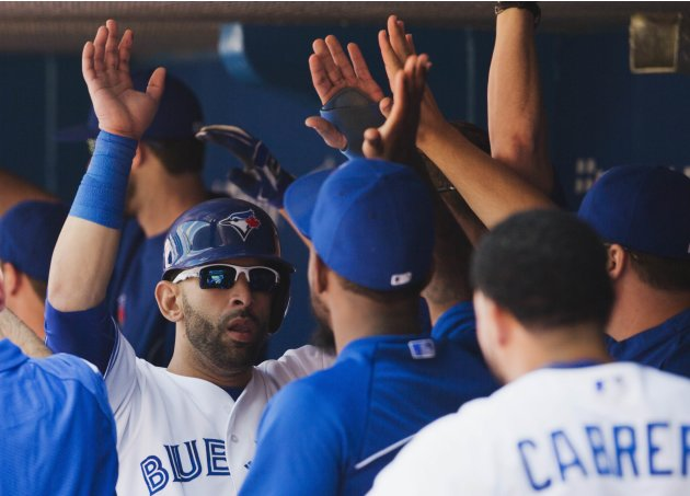 Jays' Bautista celebrates scoring against the Rays during the seventh inning of their MLB American League baseball game in Toronto
