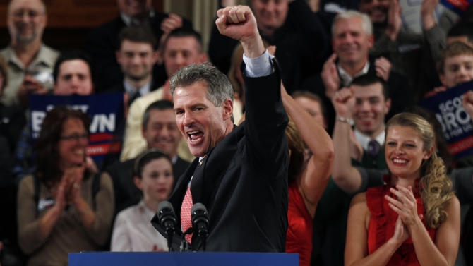 FILE - In this Jan. 19, 2012, file photo, then-Sen. Scott Brown, R-Mass., pumps his fist during his re-election campaign kick-off in Worcester, Mass., in this Jan. 19, 2012 file photo. Three years ago, Brown was a little-known Republican state senator from Massachusetts who shocked Democrats by winning a U.S. Senate seat. Now, having compiled a voting record more moderate than his tea party allies would have liked and losing his bid for a full term, Brown is considering whether to seize a second chance to return to the Senate in another special election. (AP Photo/Charles Krupa, File)