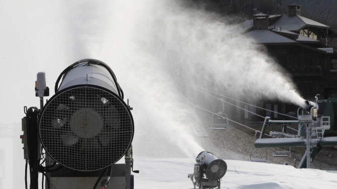 This Nov. 15, 2012 photo shows snow guns making fresh snow at the Stowe resort in Stowe, Vt. The ground might be bare, but ski areas across the Northeast are making big investments in high-efficiency snowmaking so they can open more terrain earlier and longer. (AP Photo/Toby Talbot)