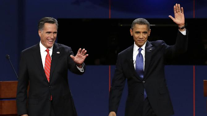 """FILE - In this Oct. 3, 2012, file photo, Republican presidential candidate Mitt Romney and President Barack Obama wave to the audience during the first presidential debate at the University of Denver in Denver. The sixth """"town hall"""" style presidential debate will bring Obama and Romney to Hofstra University on New York's Long Island Tuesday, Oct. 16, 2012. They'll take questions from undecided voters selected by Gallup. (AP Photo/Charlie Neibergall, File)"""