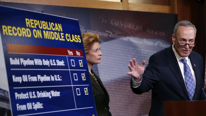 U.S. Senator Chuck Schumer and Senator Debbie Stabenow (D-MI) (L)respond to Republicans at a Democrat response news conference after voting on amendments on the Keystone XL pipeline bill on Capitol Hill in Washington