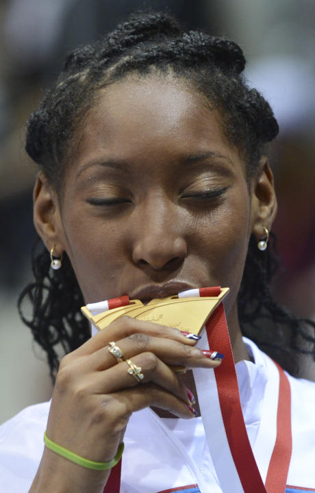 France's Eloyse Lesueur kisses her gold medal during the ceremony for the women's long jump at the Athletics Indoor World Championships in Sopot, Poland, Sunday, March 9, 2014