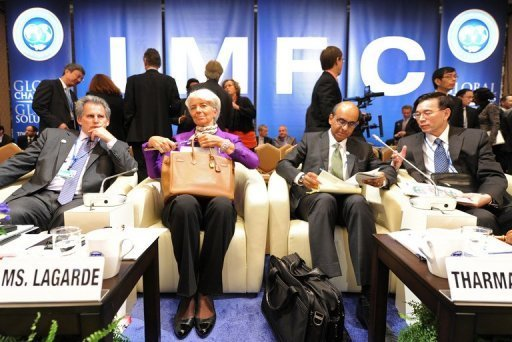 "<p>IMF Managing Director Christine Lagarde (2nd L) pictured with other officials at the annual meetings of the International Monetary Fund (IMF) and World Bank in Tokyo on October 13. Lagarde rapped Beijing, saying it would ""lose out"" by not showing up, while World Bank President Jim Yong Kim urged the two countries to sort out their differences for the good of the global economy.</p>"