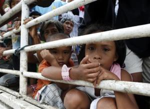 Children riding in a truck with other people made homeless…