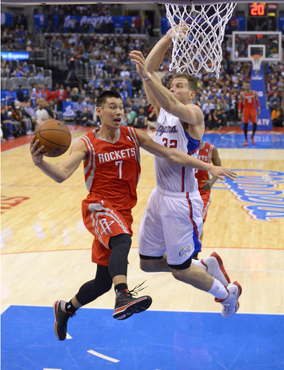 Houston Rockets guard Jeremy Lin, left, passes the ball as Los Angeles Clippers forward Blake Griffin defends during the first half of an NBA basketball game, Wednesday, Feb. 26, 2014, in Los Angeles.