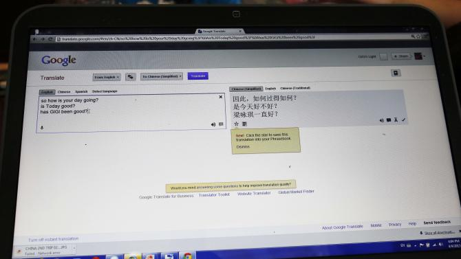 In this April 4, 2013 photograph, Phillip Smith's message to his new daughter, 14-year-old Guan Ya, is translated to Chinese using Google Translate in his laptop on Rienzi, Miss. The Smiths and their three other children are using the program to communicate almost exclusively with Guan Ya, who is deaf. The family uses iPhones, iPods and a laptop, all loaded with the program to write in either English that translates to Chinese or vice-a-versa. (AP Photo/Rogelio V. Solis)